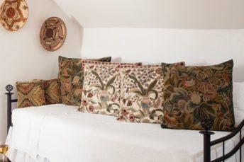 Bed and partial porch view of the Vista Room at Casa Escondida.