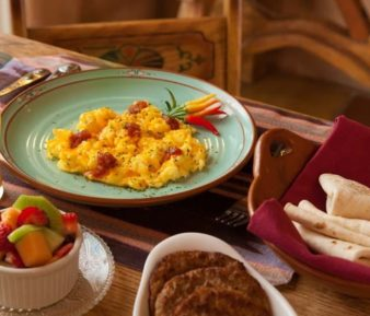 southwestern breakfast, eggs, orange juice, tortillas, fruit